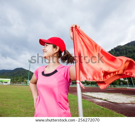 sport woman smiling and flag - stock photo