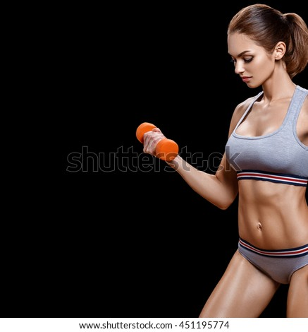 Sport. Woman sport body strong and beautiful with dumbbell isolated on white - stock photo