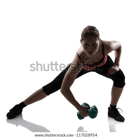 sport young athletic woman lunges with dumbbells, silhouette studio shot over white background - stock photo