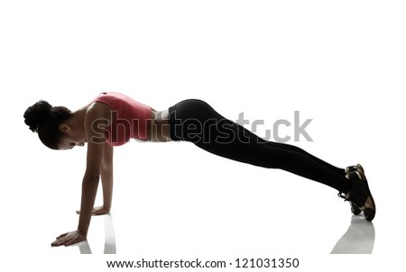 sport young woman doing push-up exercise, fitness girl silhouette studio shot over white background - stock photo