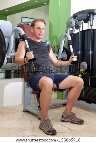 sporting man in fitness center