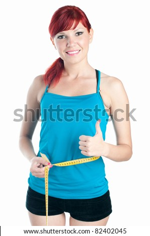 Sportive caucasian woman measuring her waist with a centimeter - stock photo