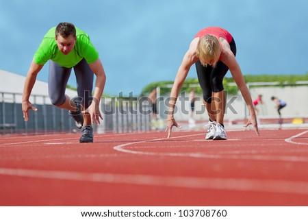 Sportive couple starts the race - stock photo