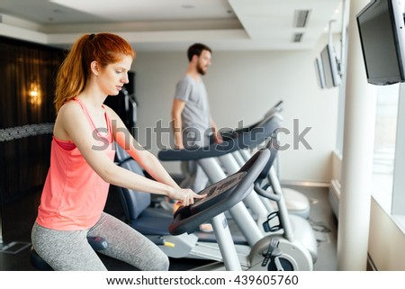 Sportive people cardio exercising in gym