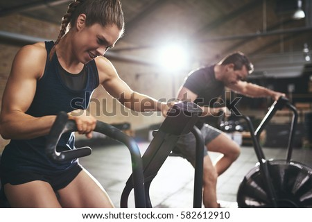 Sportive People While Cardio Training In Gym Horizontal Indoors Shot