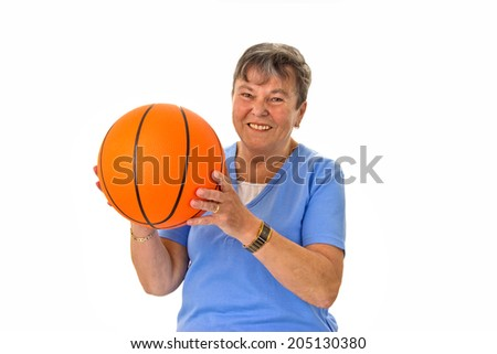 Sportive senior woman with basketball - isolated - stock photo