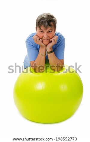 Sportive senior woman with fitness ball - isolated - stock photo