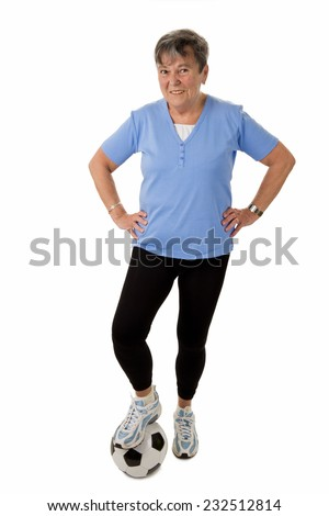 Sportive senior woman with football - isolated - stock photo
