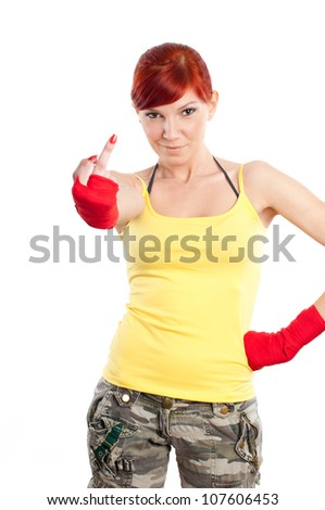 Sportive young woman in boxing bandage showing her middle finger at camera