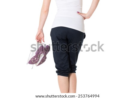 Sportive young woman with sneakers. Rear view. - stock photo