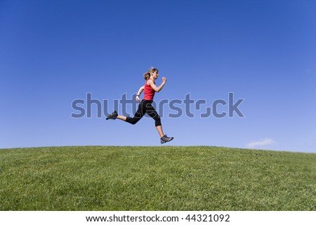 Sportive young women running on the nature