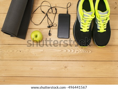 Sports accessories for fitness on the wooden floor. Healthy lifestyle concept.