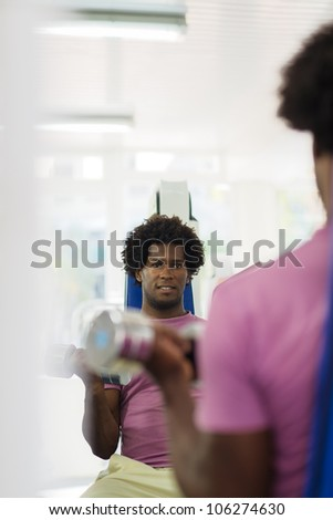 Sports activity, young african man exercising and working out in fitness gym. Copy space - stock photo
