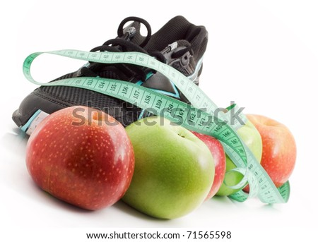 Sports and fruit diet, running shoes with apples on a white background - stock photo