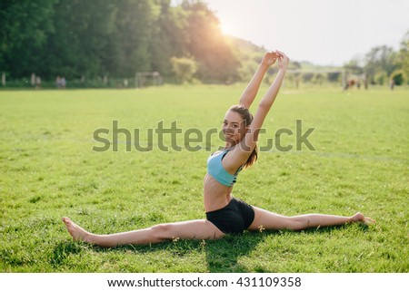 Sports and yoga girl sits on twine