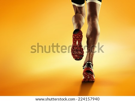 Sports background. Runner feet running closeup on shoe. - stock photo