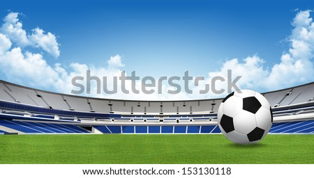 Sports background - soccer ball on green stadium  - stock photo