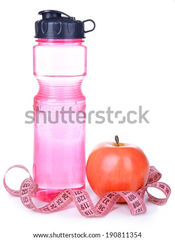 Sports bottle, apple and measuring tape isolated on white - stock photo