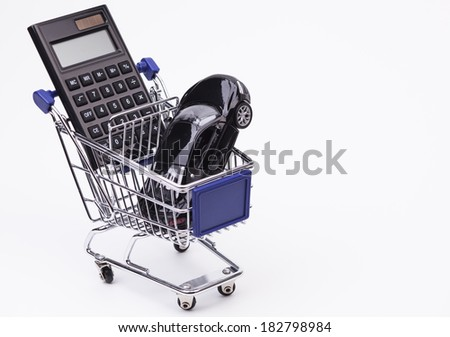 Sports car calculator and cart isolated on white background  - stock photo
