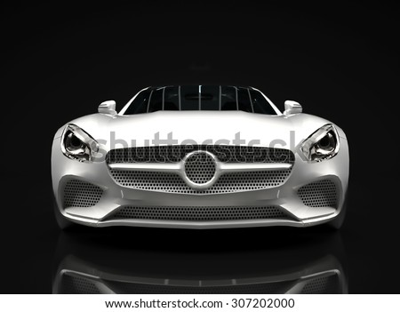 Sports car front view. The image of a sports white car on a black background - stock photo