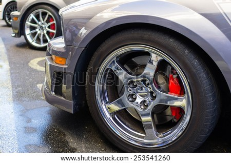 sports car wheels, low profile tires on aluminum rims - stock photo
