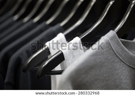 sports clothing on hangers, abstract background - stock photo
