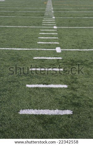 sports court with yards marked in white