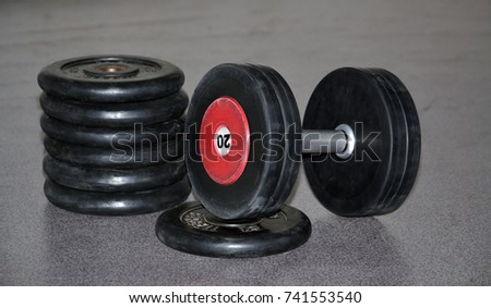 Sports dumbbell with the weights.