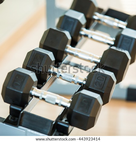 Sports dumbbells in modern sports club. Weight Training Equipment - stock photo