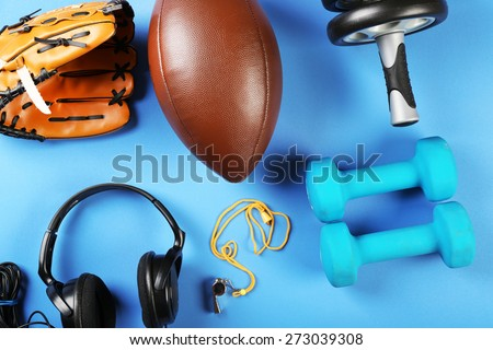 Sports equipment on color table, top view - stock photo