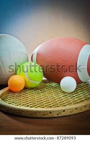 sports equipment. Tennis and racquet,rugby and volleyball - stock photo