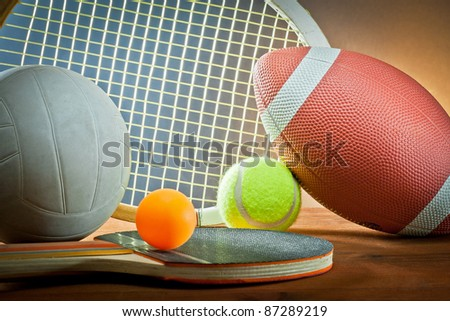 sports equipment. Tennis,rugby,volleyball and ping pong - stock photo