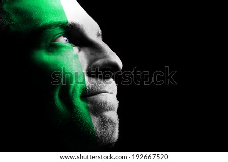 Sports fan from Nigeria . Isolated on black. - stock photo
