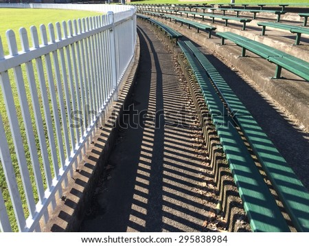Sports Field Fence and Spectator Benches - stock photo
