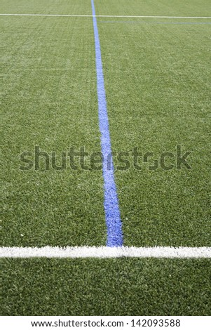 Sports field with artificial turf football and sports symbols, Entertainment