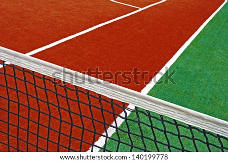 Sports field with synthetic turf, markings and netting used in tennis.Detail. - stock photo