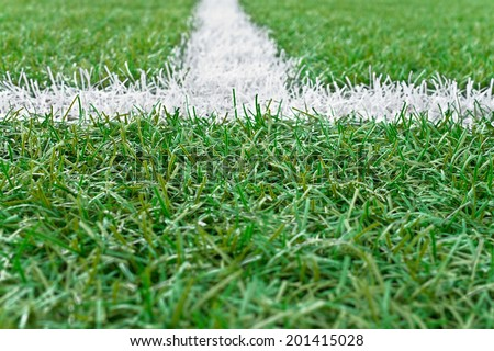 Sports field with white line markings.Small depth of field. - stock photo