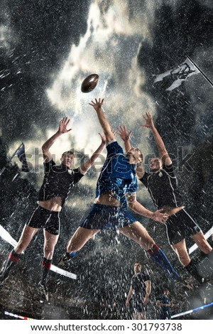 Sports, game, fighting, rain, stadium - Rugby players on a stadium - stock photo