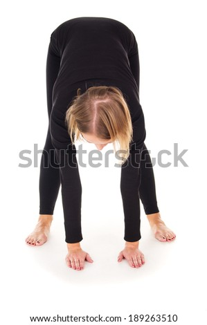 Sports girl doing stretching isolated on white background - stock photo