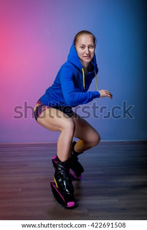 Sports girl in shoes for kangoo fitness exercising - stock photo