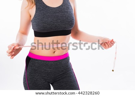 Sports girl measures the waist