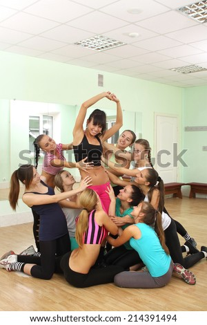 sports girsl with an athletic body is engaged in fitness. good health, active movement - stock photo