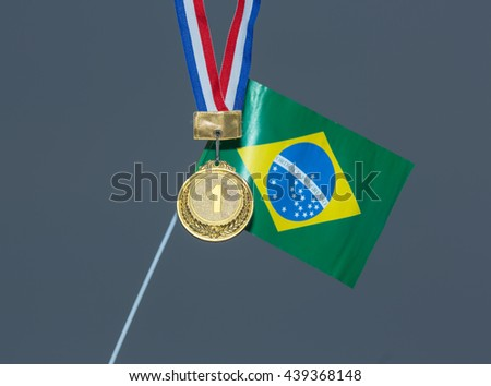 sports gold medal and a Brazilian flag - stock photo
