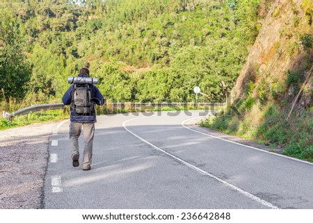 Sports guy goes camping. On the highway. - stock photo