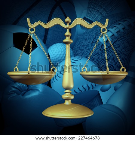 Sports law concept with sport equipment and a legal scale of justice symbol as an icon for amateur and professional sport contract dispute or athlete arbitration procedures for the sporting industry. - stock photo