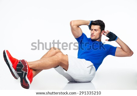 Sports man doing abdominal exercises isolated on a white background - stock photo