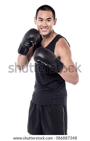 Sports man wearing boxing gloves on white background - stock photo