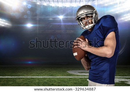 Sports manto throwing the ball against american football arena