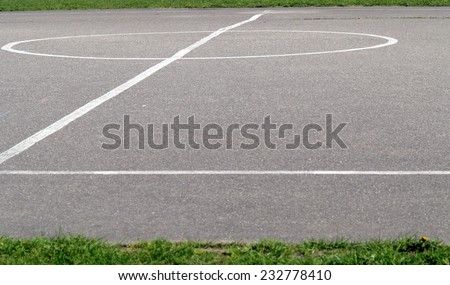 Sports markings on asphalt school playground,  basketball lines on an outdoor court