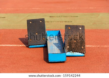 sports meet--the detail on the playground--starting block - stock photo